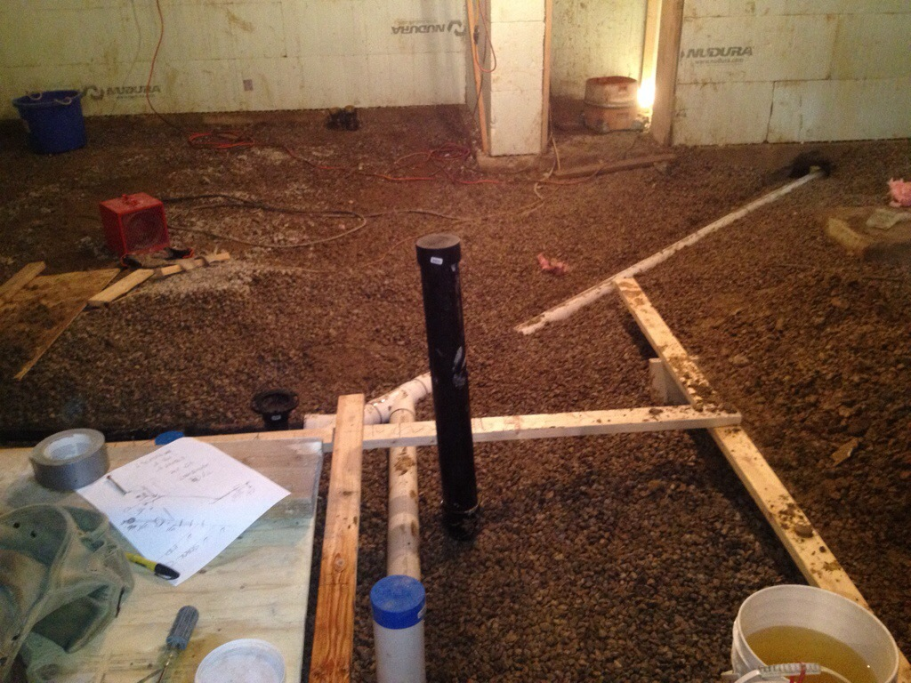 basement plumbing roughins as they extend under through the footings
